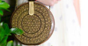 Handpainted wood clutch by Memeraki