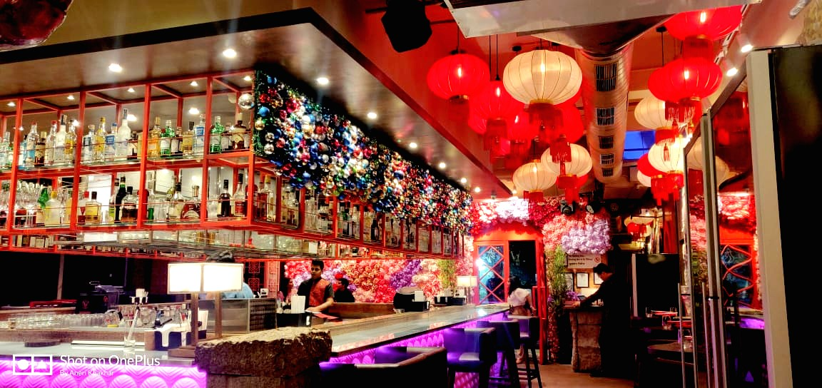 More than 100 golden and red traditional Chinese lanterns hang in the restaurant