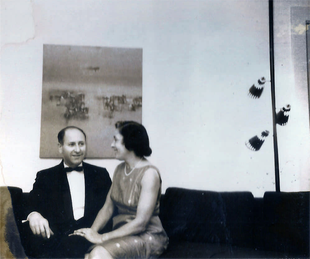 Robert and Ruth Marshak with Vasudeo S. Gaitonde's Untitled (1962) in the background at their home in USA. Image courtesy: The Marshak Family Archives