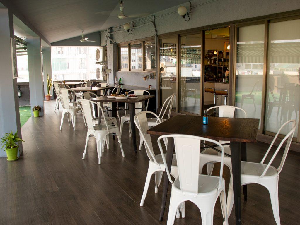 Outdoor seating at Yogisattva Cafe, Khar (West)